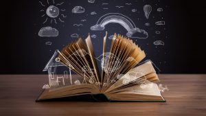 Open book with hand drawn landscape © ra2 studio - Fotolia