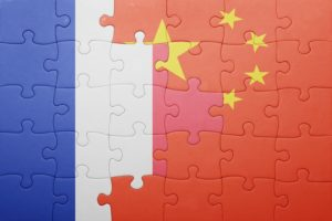 puzzle with the national flag of france and china