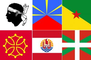 Drapeaux de la Corse, de La Réunion, de la Guyane, de l'Occitanie, de la Polynésie Française, et du Pays Basque / Wikimedia Commons / Licence CC