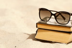Books on a beach / Shutterstock